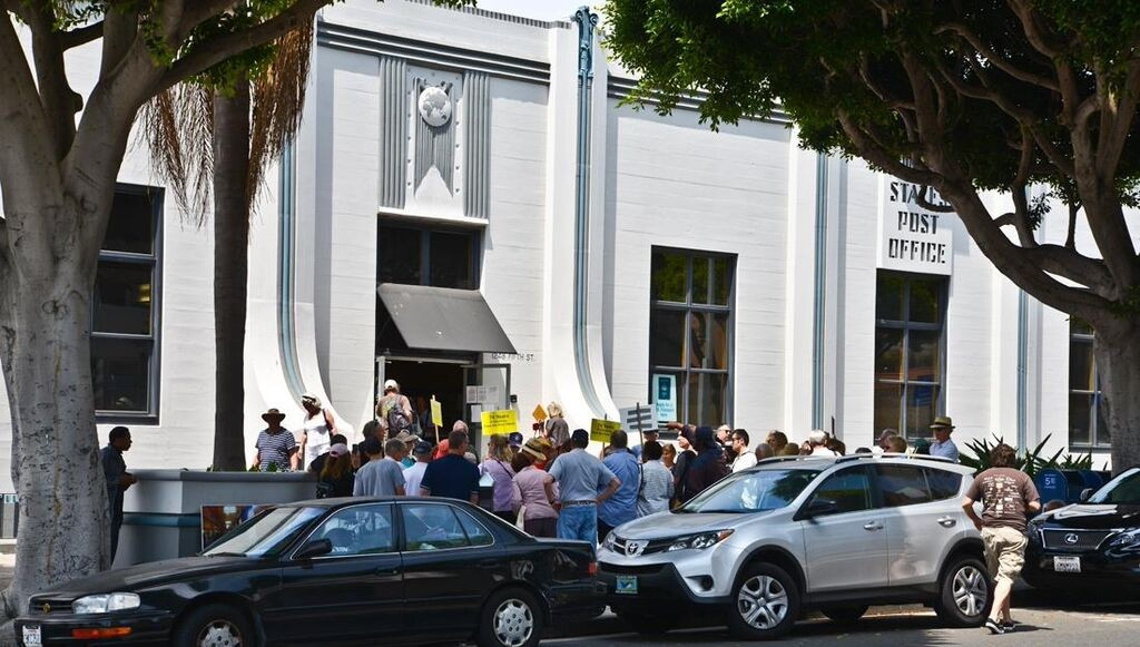 Photo caption: Over 90 people gathered for the Conservancy's rally for the preservation of the historic 5th Street Post Office on June 29, 2013, its last day of operation Photo Credit Mike Crosby